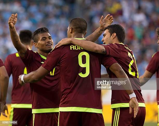 Salomon Rondon Josef Martinez and Alexander Gonzalez of Venezuela react after a goal against Uruguay during the 2016 Copa America Centenario Group C...