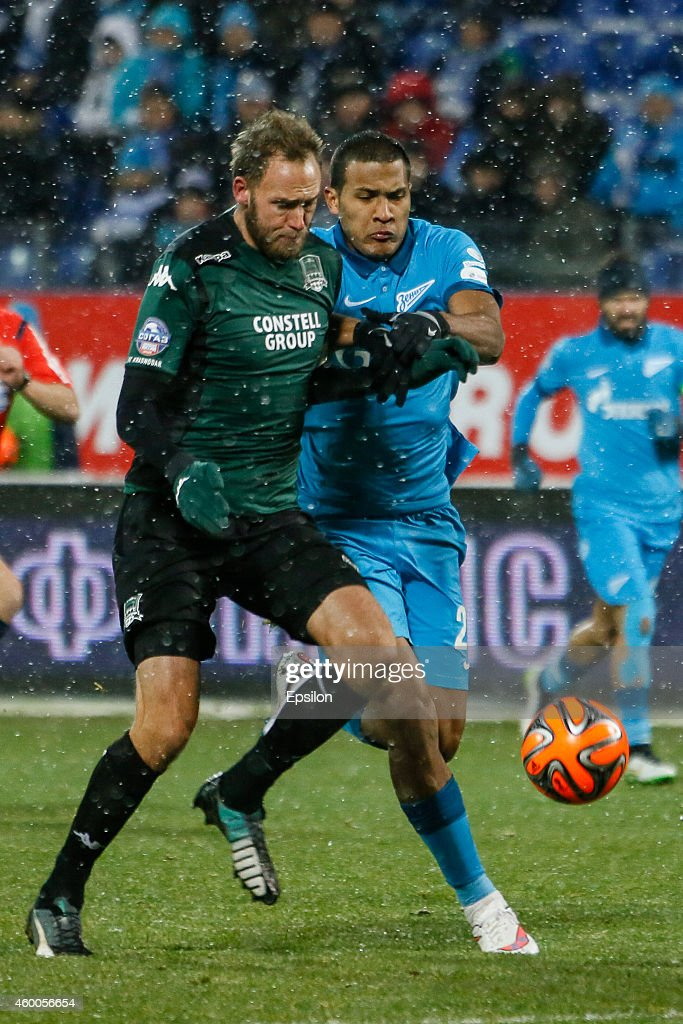 Salomon Rondon of FC Zenit St. Petersburg (R) and Andreas Granqvist of FC Krasnodar vie for the ball during the Russian Football League Championship match between FC Zenit St. Petersburg and FC Krasnodar at the Petrovsky stadium on December 6, 2014 in St. Petersburg, Russia.