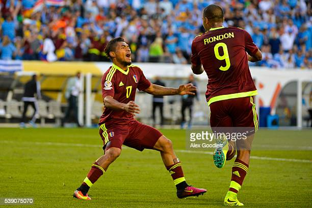 Salomon Rondon of Venezuela celebrates with his teammate Josef Martinez during a group C match between Uruguay and Venezuela at Lincoln Financial...