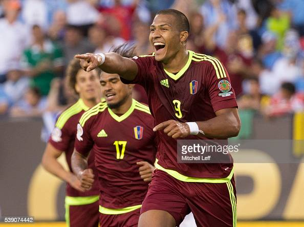 Salomon Rondon of Venezuela reacts after his goal along with Josef Martinez against Uruguay during the 2016 Copa America Centenario Group C match at...