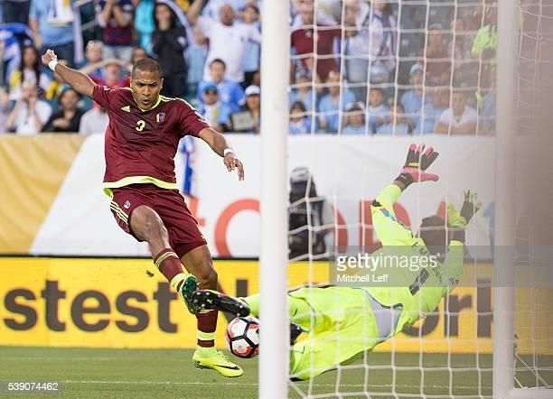 Salomon Rondon of Venezuela scores a goal past Fernando Muslera of Uruguay during the 2016 Copa America Centenario Group C match at Lincoln Financial...