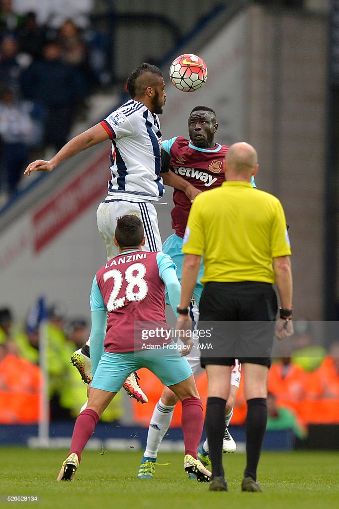 Salomon Rondon of West Bromwich Albion and Cheikhou Kouyate of West Ham United compete during the Barclays Premier League match between West Bromwich Albion and West Ham United at The Hawthorns on April 30, 2016 in West Bromwich, United Kingdom.