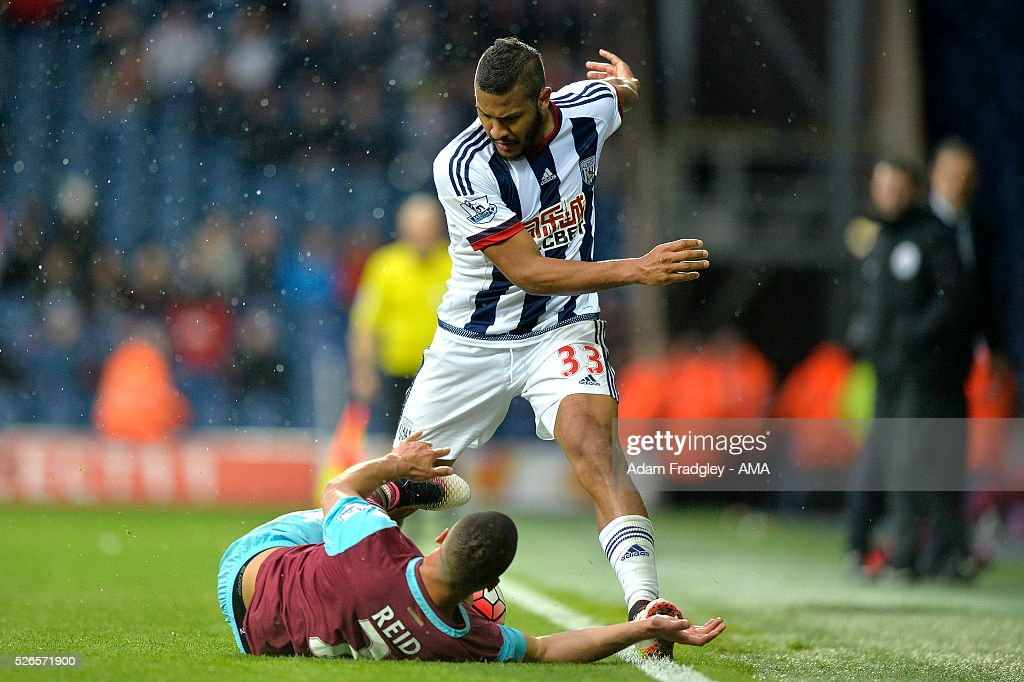 Salomon Rondon of West Bromwich Albion and Winston Reid of West Ham United tangle during the Barclays Premier League match between West Bromwich Albion and West Ham United at The Hawthorns on April 30, 2016 in West Bromwich, United Kingdom.