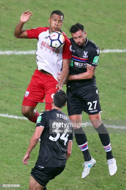 Salomon Rondon of West Bromwich Albion battles Damien Delaney of Crystal Palace during the Premier League Asia Trophy match between West Brom and...