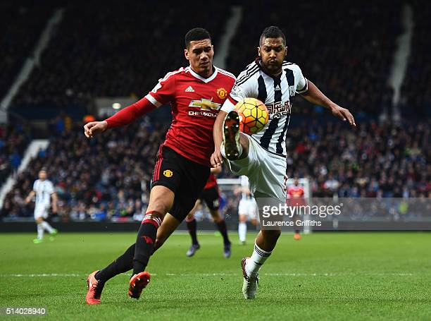 Salomon Rondon of West Bromwich Albion challenges for the ball with Chris Smalling of Manchester United during the Barclays Premier League match...