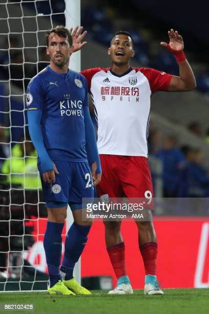 Salomon Rondon of West Bromwich Albion competes with Christian Fuchs of Leicester City during the Premier League match between Leicester City and...