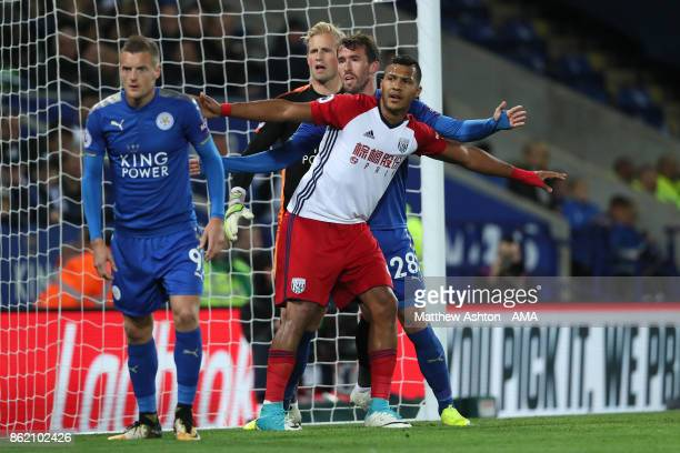 Salomon Rondon of West Bromwich Albion competes with Kasper Schmeichel and Christian Fuchs of Leicester City during the Premier League match between...