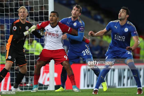 Salomon Rondon of West Bromwich Albion competes with Kasper Schmeichel of Leicester City during the Premier League match between Leicester City and...
