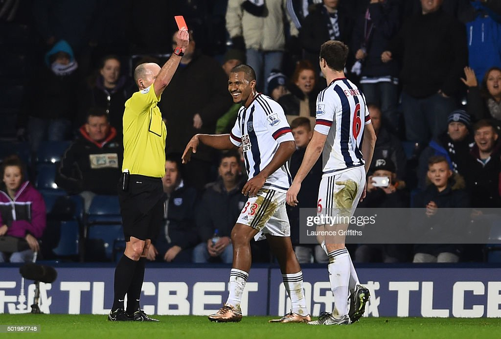 Salomon Rondon of West Bromwich Albion is shown a red card by referee <a gi-track='captionPersonalityLinkClicked' href=/galleries/search?phrase=Mike+Dean+-+%C3%81rbitro&family=editorial&specificpeople=4517613 ng-click='$event.stopPropagation()'>Mike Dean</a> during the Barclays Premier League match between West Bromwich Albion and A.F.C. Bournemouth at The Hawthorns on December 19, 2015 in West Bromwich, England.