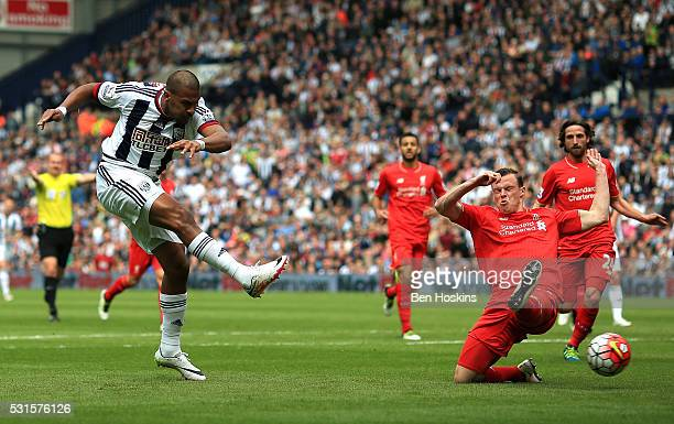 Salomon Rondon of West Bromwich Albion scores his team's first goal during the Barclays Premier League match between West Bromwich Albion and...