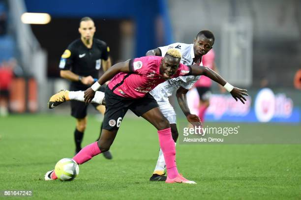Salomon Sambia of Montpellier and Jean Michael Siri of Nice during the Ligue 1 match between Montpellier Herault SC and OGC Nice at Stade de la...