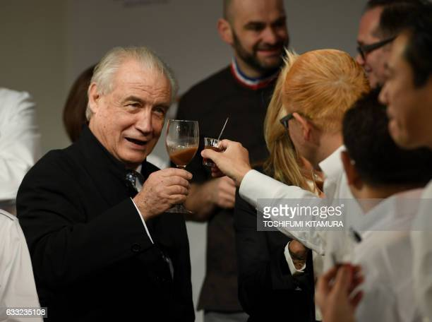Salon du Chocolat trade show organiser Francois Jante makes a toast with a chocolatier during the opening of the 15th Salon du Chocolat trade show in...