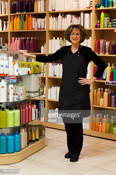 Salon Woman Stands with Sale Hair Products