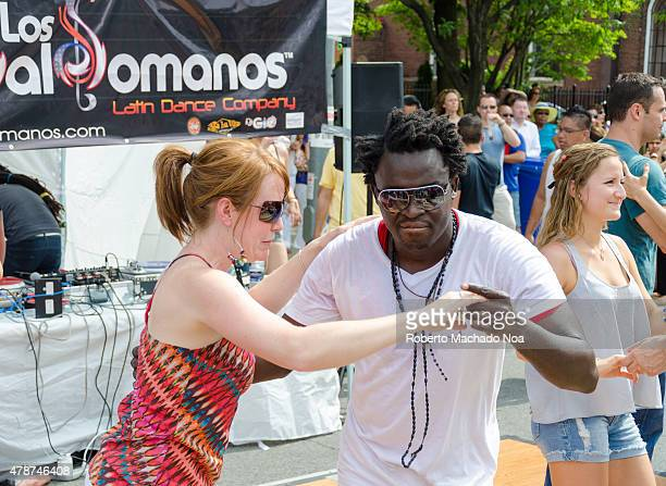 WEST TORONTO ONTARIO CANADA Salsa on St Saint Clair Festival Scenes mixed race couple trying out some Latin dance steps are part of the Salsa on St...