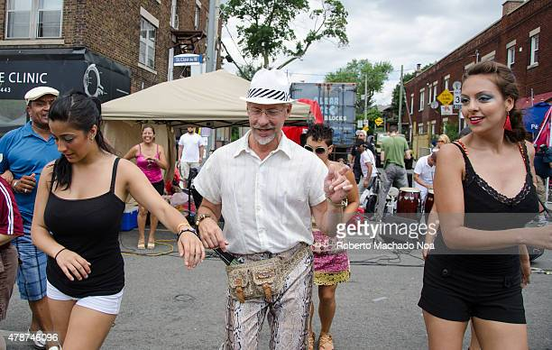 WEST TORONTO ONTARIO CANADA Salsa on St Saint Clair Festival Scenes Two young women and a more mature man learn to dance the salsa at a street...
