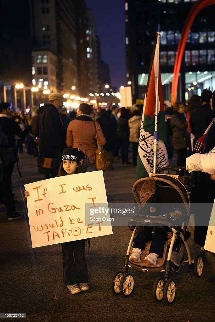 Salsabeel Awwad, 7, participates in a demonstration against Israeli attacks on Gaza on November 19, 2012 in Chicago, Illinois. Several hundred people joined the protest which started with a rally in the Federal Building Plaza and finished with a march through the Loop during rush hour.