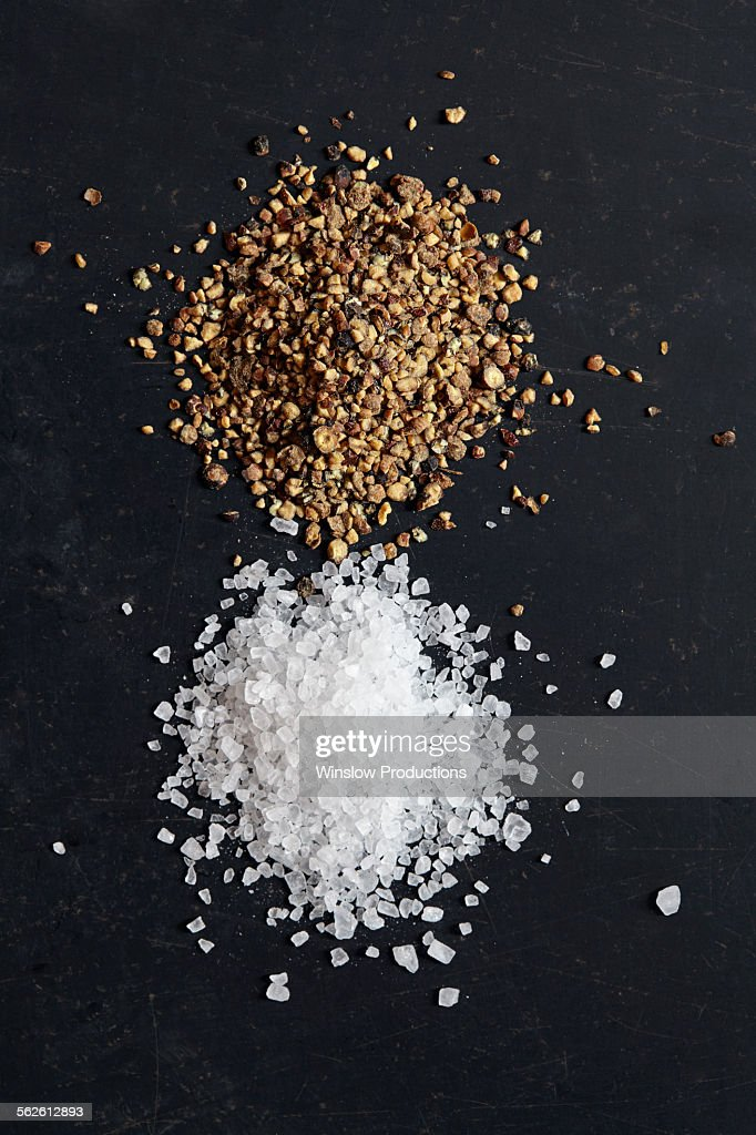 Salt and pepper on black background