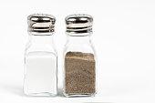 Salt and pepper shaker on white background.