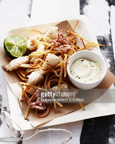 Salt and pepper squid with sauce : Stock Photo
