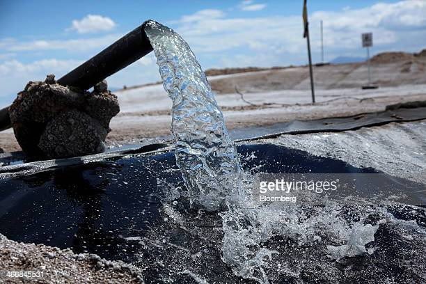 Salt brine is pumped from under the Uyuni Salt Flats into evaporation pools to produce lithium bicarbonate during the process of lithium production...