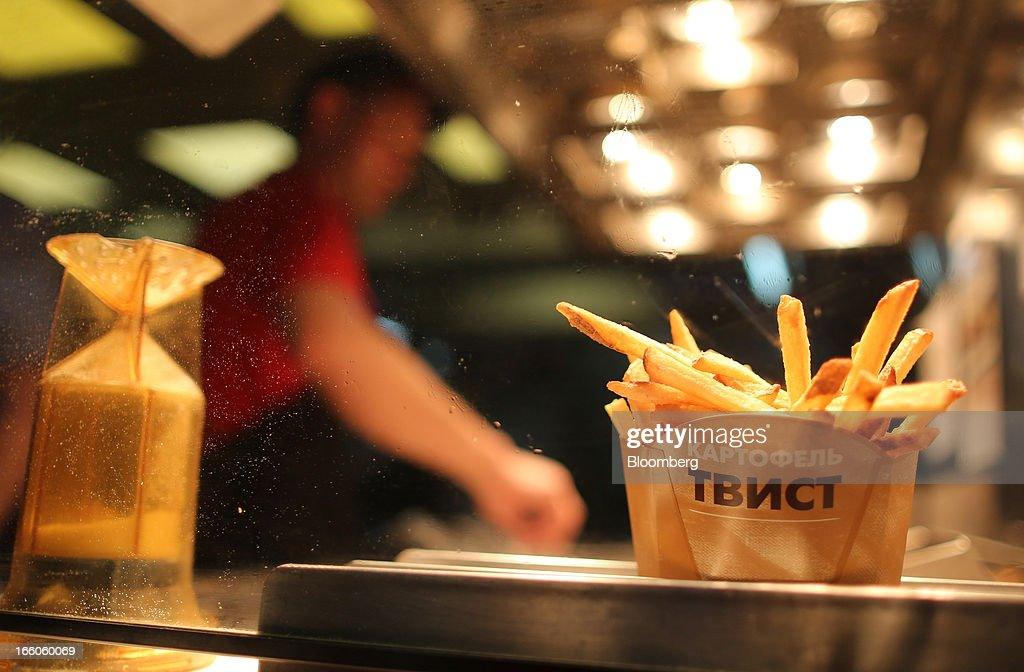 A salt cellar stands beside a portion of french fries in the kitchen area of a Wendy's fast food restaurant in Moscow, Russia, on Friday, April 5, 2013. McDonald's, which virtually created the market for burgers and fries in the country and convinced Russians it's OK to eat with their hands, must fend off a growing challenge from rivals Burger King Worldwide Inc., Subway Restaurants, Yum! Brands Inc. and Wendy's Co. Photographer: Andrey Rudakov/Bloomberg via Getty Images