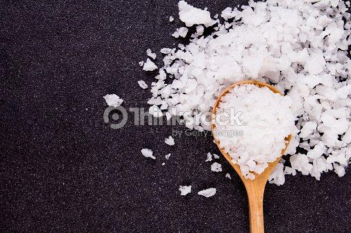 salt crystals on black stone plate background stock photo thinkstock