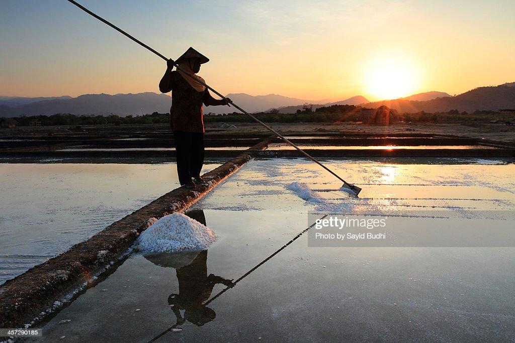 Salt Farmer in Silhouette Sunset