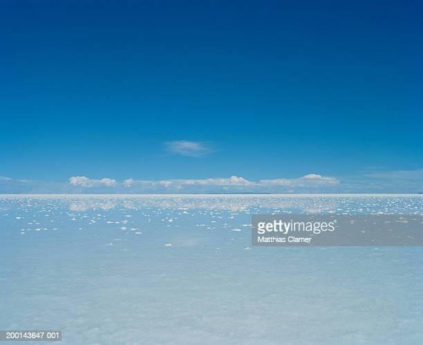 Salt flat under blue sky