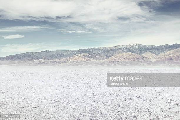 Salt flat with distant mountains