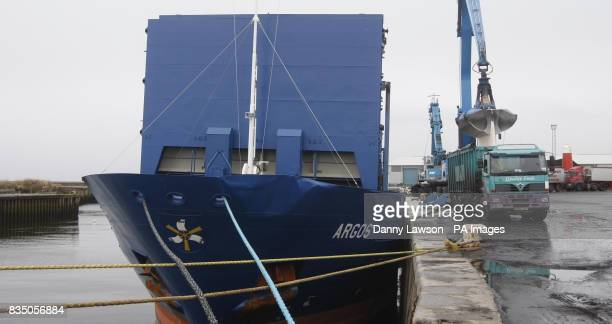 Salt from Ibiza to combat Britain's grit shortage in the face of heavy snow is loaded from a ship into waiting trucks on the North Harbour quay in...