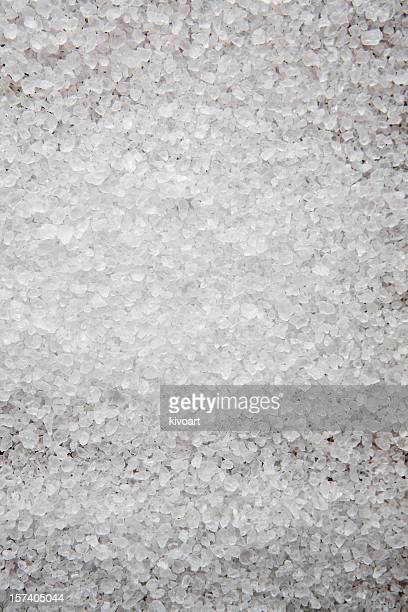 Salt grains scattered on a background