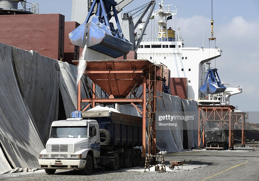 Salt is unloaded onto a truck at the Port of Santos in Santos, Brazil, on Friday, July 5, 2013. Rising borrowing costs and the global bond selloff triggered by the prospect of reduced U.S. stimulus are prompting Brazilian investors to boost holdings of the countrys floating-rate securities. Photographer: Paulo Fridman/Bloomberg via Getty Images