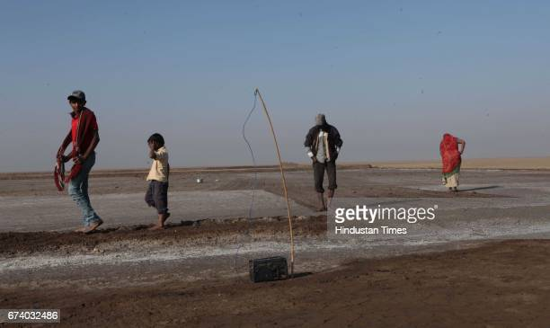 Salt Pan workers used a transistor with antenna for their entertainment during working in sunny day without resources around in order to make the...