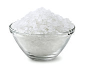 Glass bowl of salt isolated on white