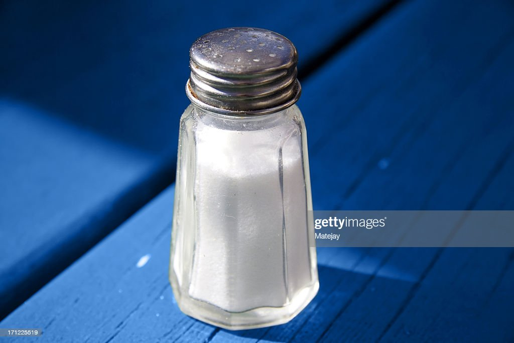 Salt shaker on blue
