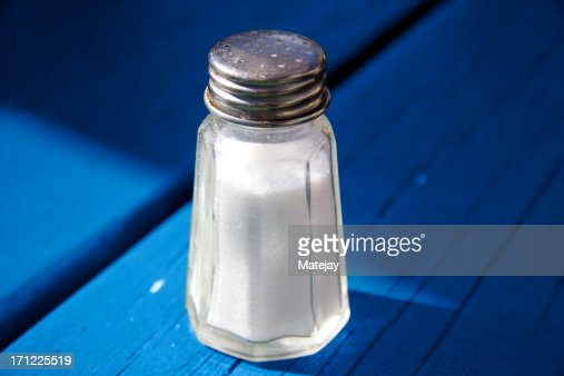 Salt shaker on blue