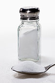 Salt shaker with teaspoon