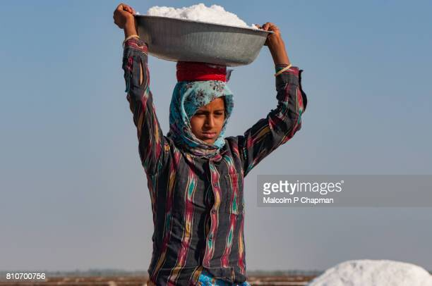 Salt worker, young woman, on the Little Rann of Kutch, salt pans near Dhrangaghra, Gujarat, India.