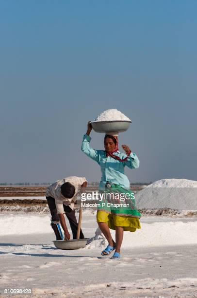 Salt workers on the Little Rann of Kutch, salt pans near Dhrangaghra, Gujarat, India.