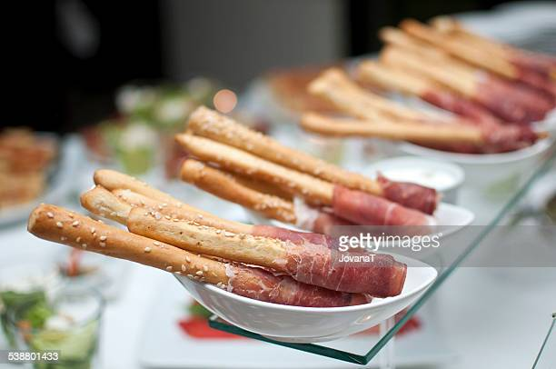 Salted breadsticks rolled with prosciutto