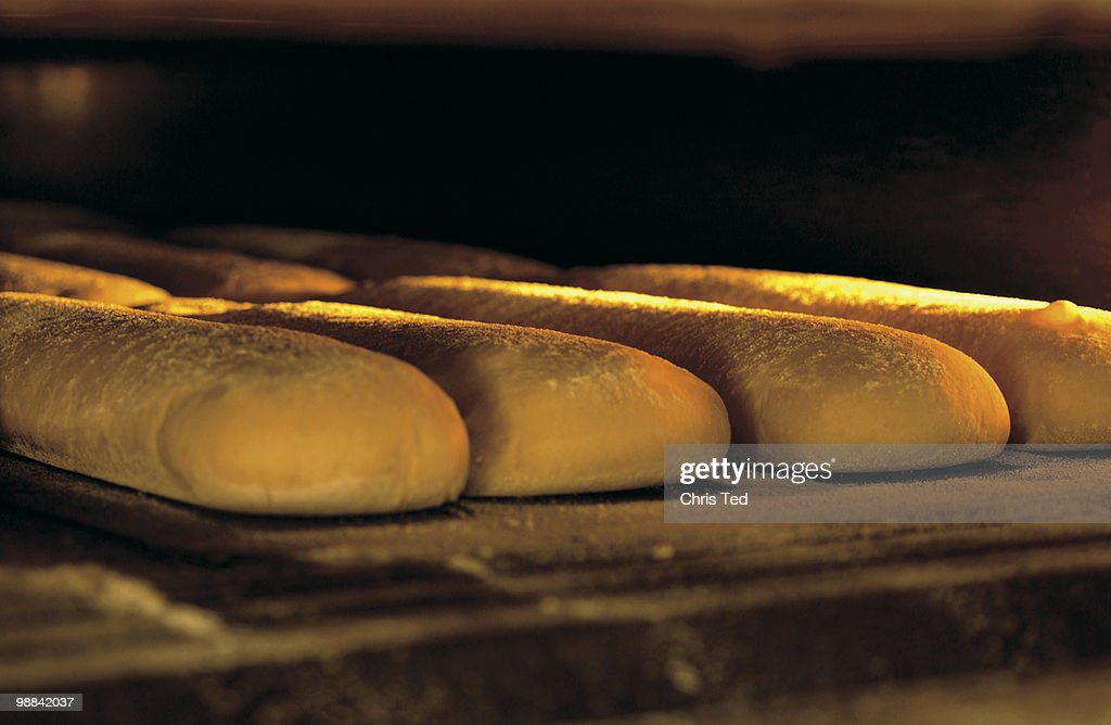 Salted Bruschettina in the oven : Stock Photo