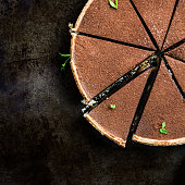 Slices of Salted Caramel andChocolate Tart on Dark Background