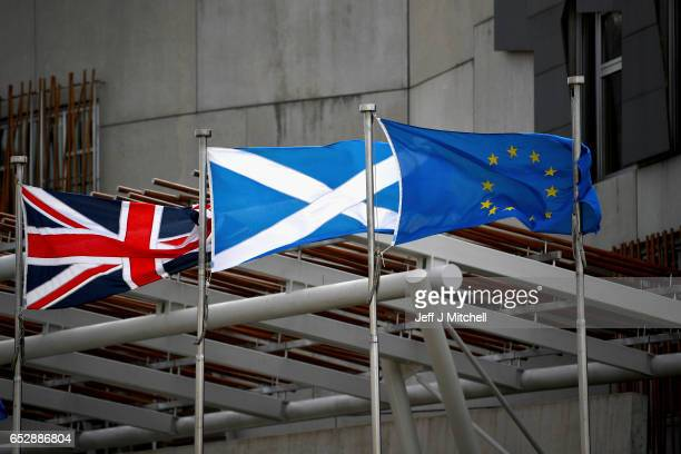 Saltire Union Jack and EU flags flutter in the wind outside the Scottish Parliament on March 13 2017 in Edinburgh Scotland Scotland's First Minister...