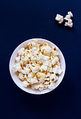 Salty movie theater popcorn in a bowl ready-to-eat