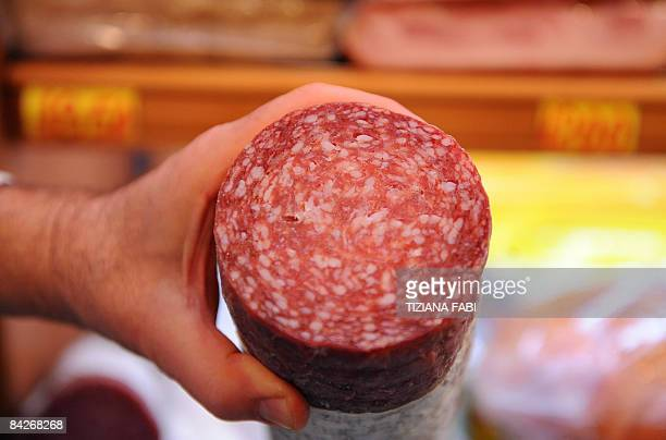 A 'salumiere' a shop keeper of a salami shop shows two different Italian salamis on January 13 2009 in Rome A new research published in a German...