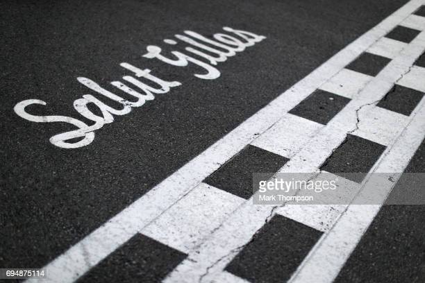 Salut Gilles marking on the track for the circuits namesake Gilles Villeneuve during the Canadian Formula One Grand Prix at Circuit Gilles Villeneuve...