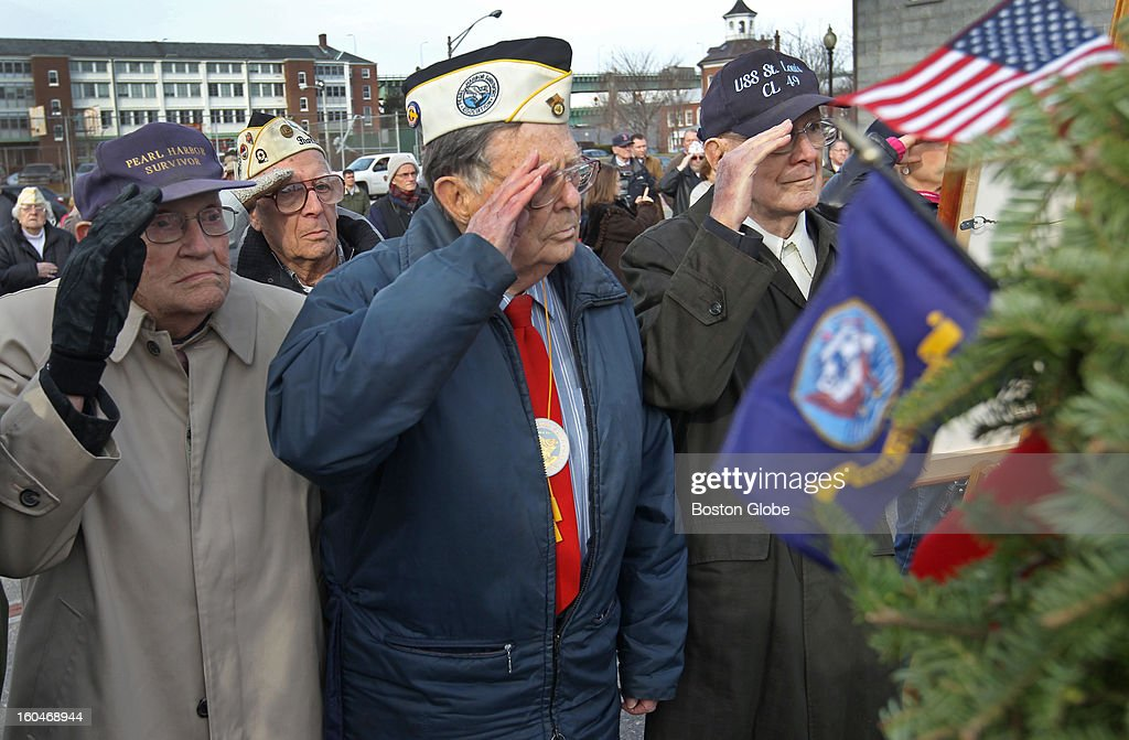 A salute by vets who were at Pearl Harbor, during a wreath ceremony. From left to right: Donald Tabbut, Emery Arsenault, Gerald Halterman and Francis M Connolly. Boston National Historical Park hosts a memorial service on the bow of the World War II destroyer USS Cassin Young in the Charlestown Navy Yard on Friday, December 7, 2012 from 12:30 to 1:00 p.m. to commemorate the 1941 surprise attack by the Japanese on the U.S. naval base at Pearl Harbor, Hawaii. USS Cassin Young is named for U.S. Navy Commander Cassin Young who was awarded the Medal of Honor for his actions during the attack on Pearl Harbor.