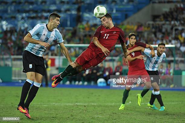 Salvador Agra of Portugal heads the ball above Lautaro Gianetti of Argentina as Paciencia Goncalo of Portugal and Lisandro Magallan of Argentina look...
