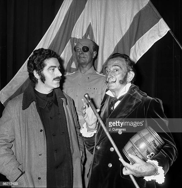 Salvador Dali Spanish painter and Paco Rabanne Spanish dressmaker in front of the wax model of the Israeli General and politician Moshe Dayan Paris...