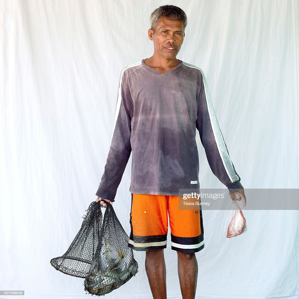 Salvador Layaog fisherman with his catch Pooc Bantayan Island The Philippines Every morning at 7 am fisherwomen meet fishermen as they return from...